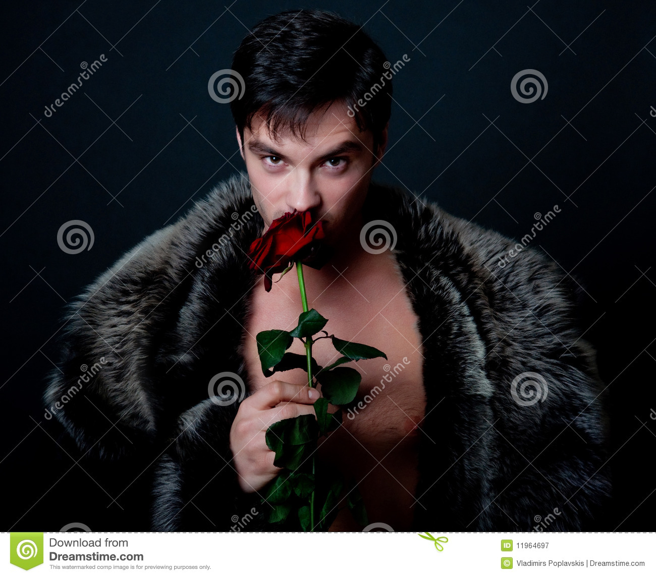 Young handsome man with rose