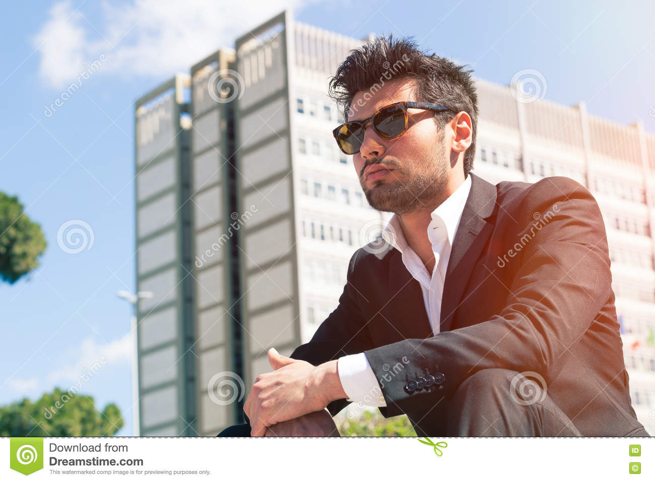 Young handsome man with sunglasses. Career and job opportunities.