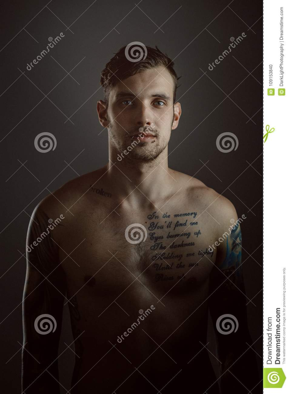Young handsome man with tattoos