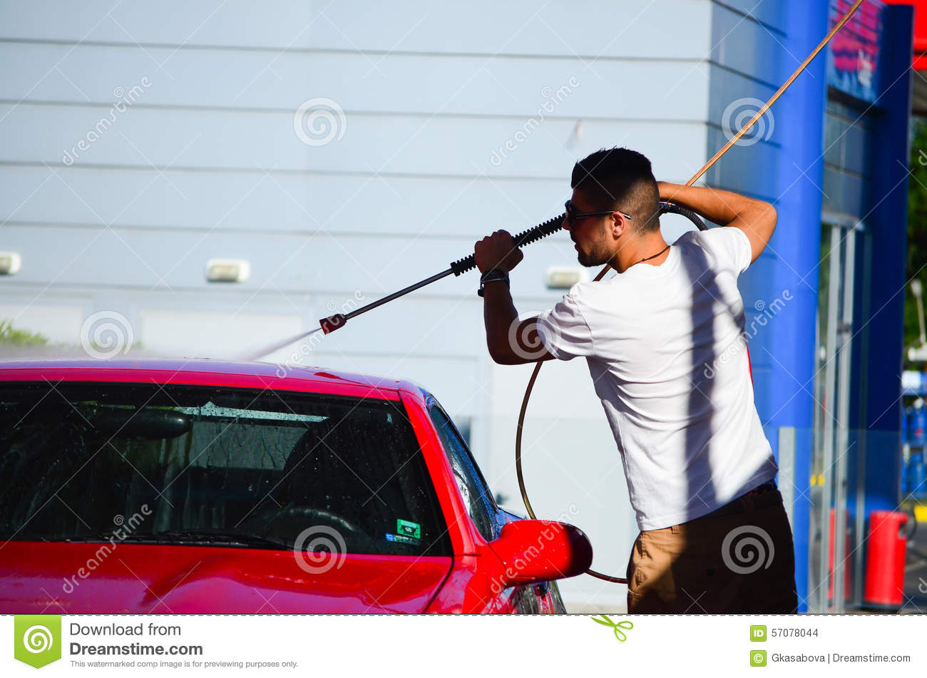 Download Young Handsome Man Washing Car Stock Photo - Image of interior, hose: 57078044