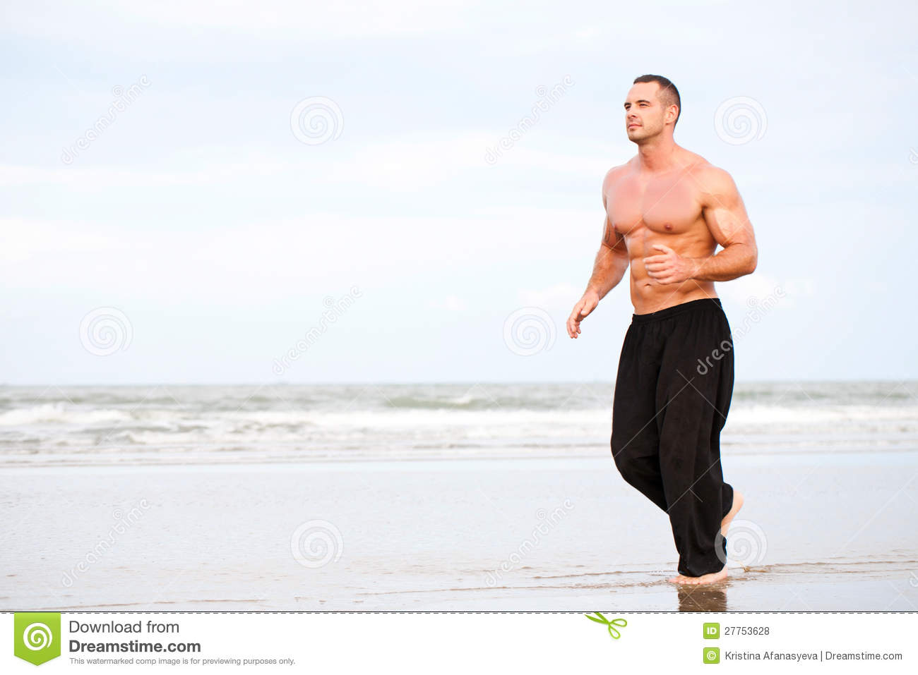 Young Handsome Muscular Man Running On The Beach Designjpg