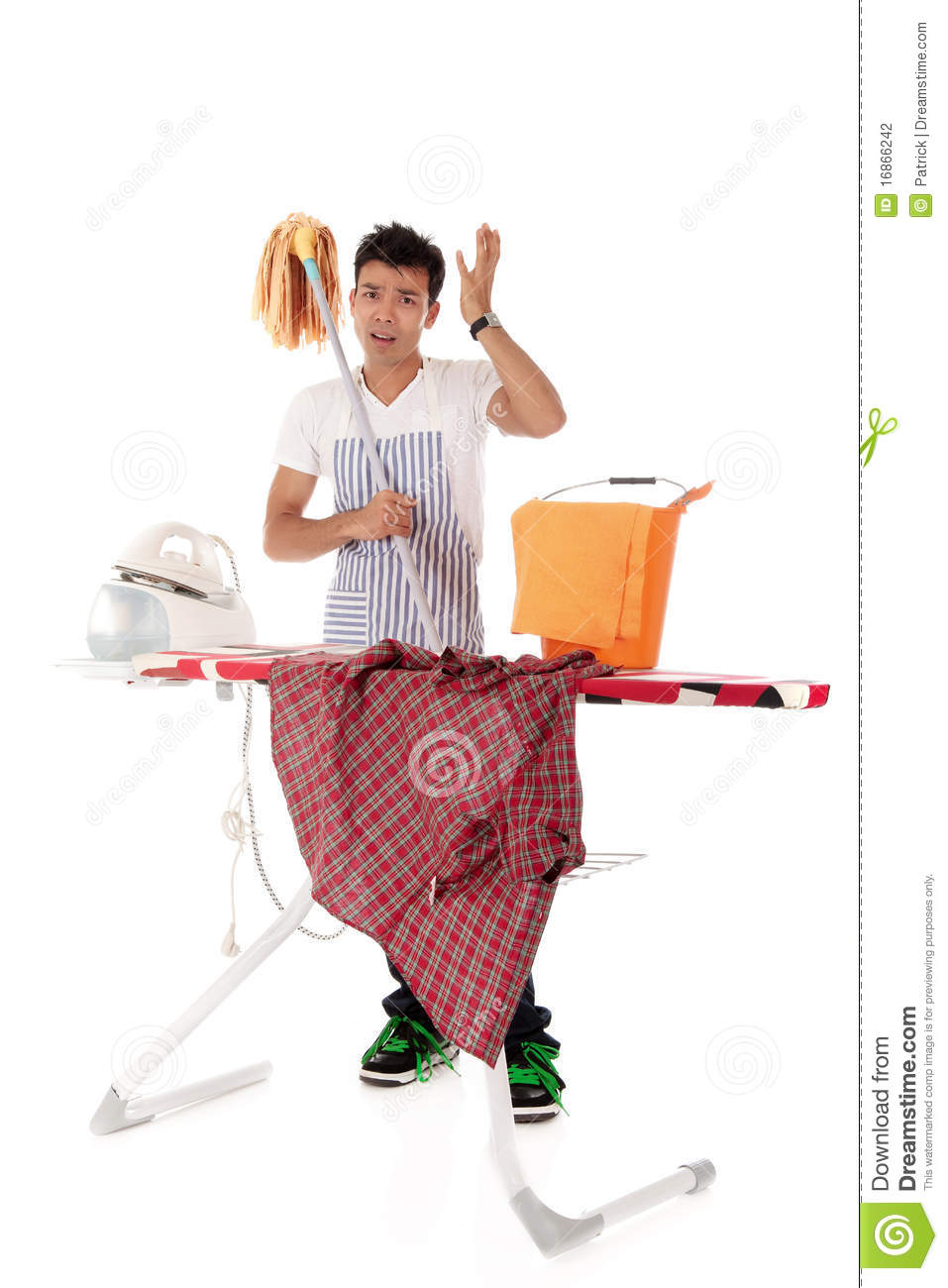 Young handsome Nepalese man, ironing, cleaning