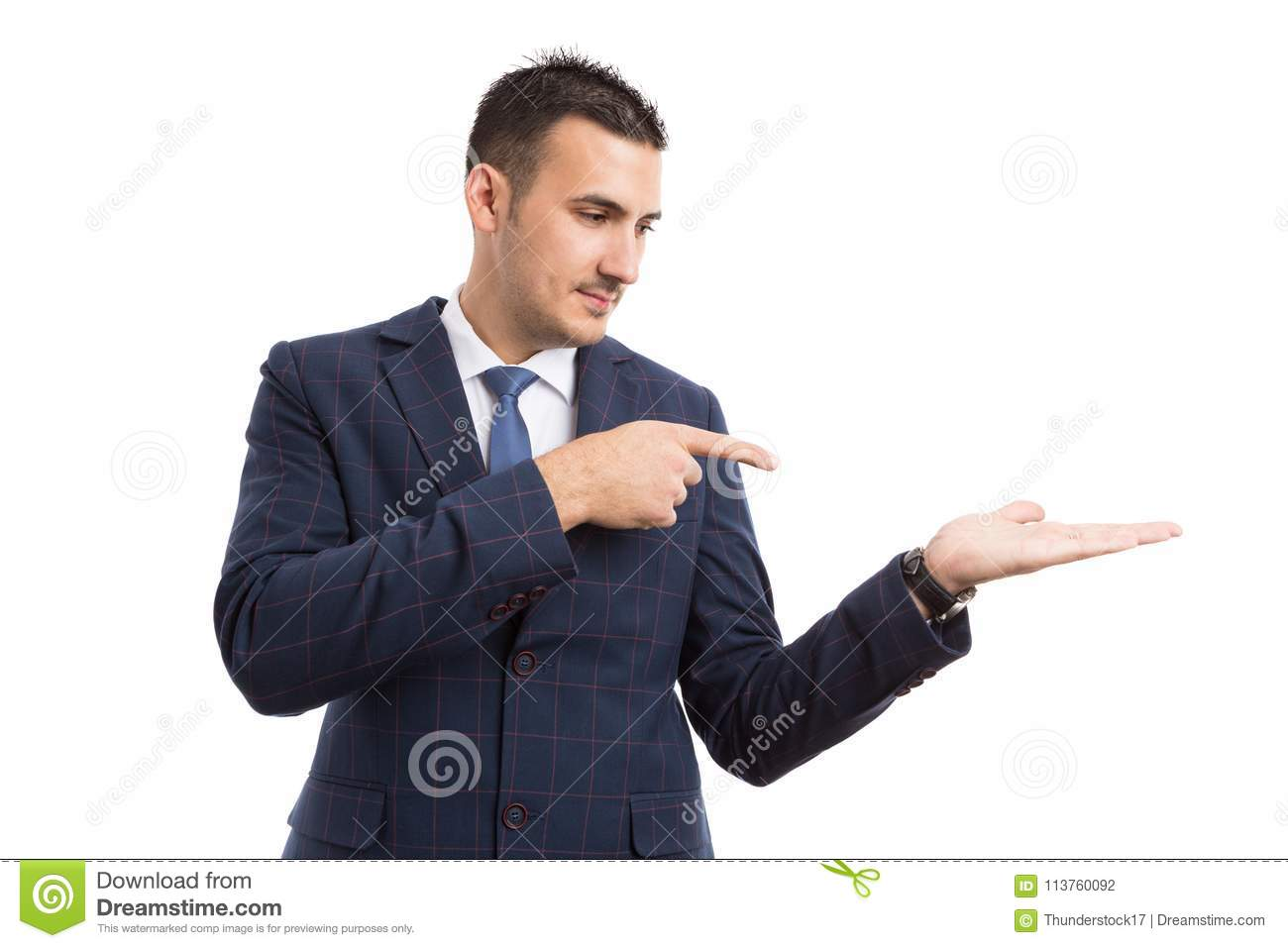 Young handsome salesman or businessman pointing to an option