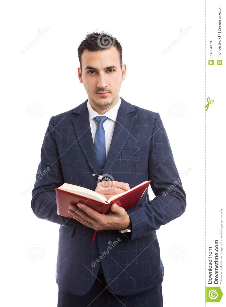 Young handsome salesman writing in agenda