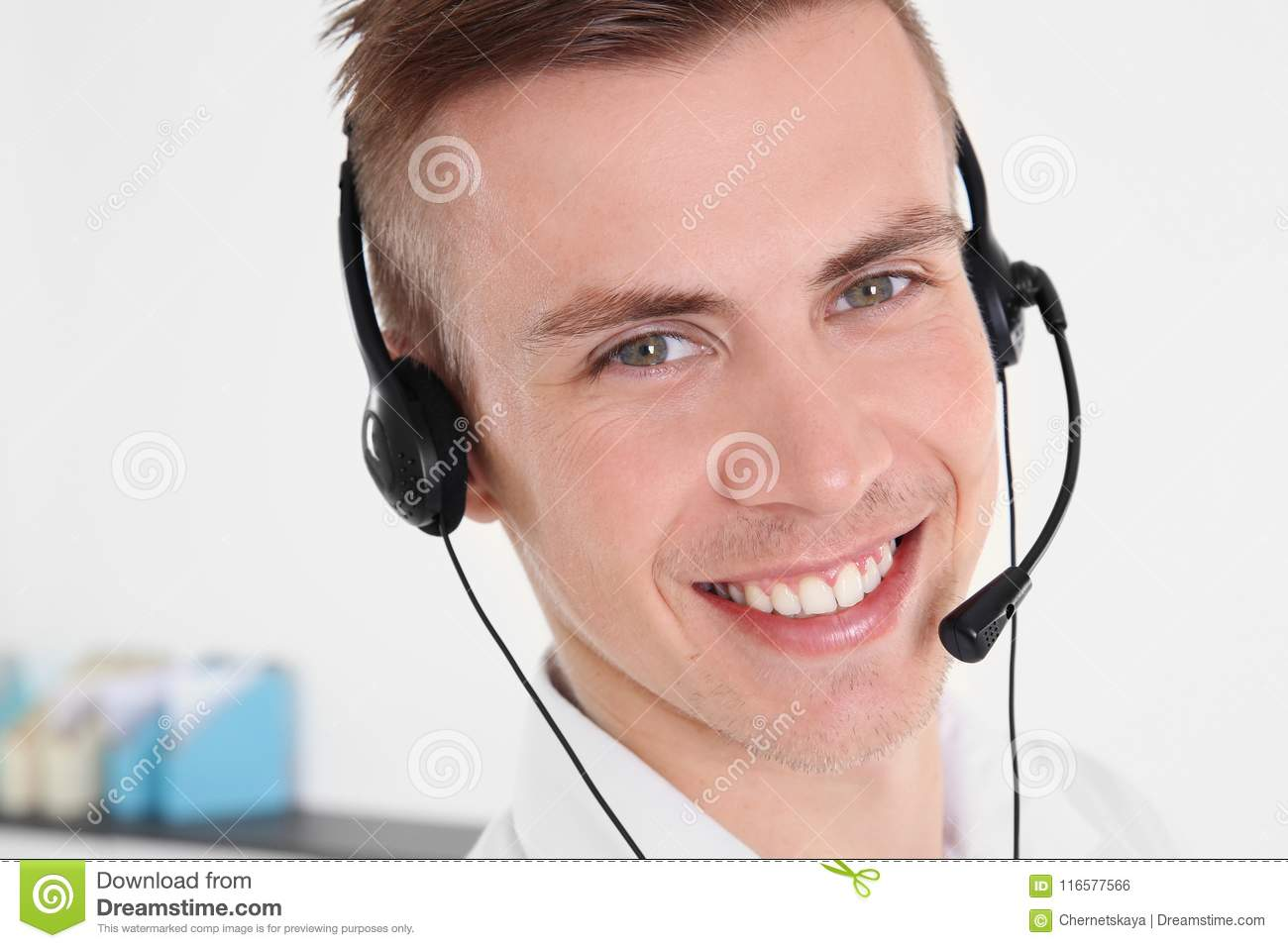 Young handsome technical support dispatcher working