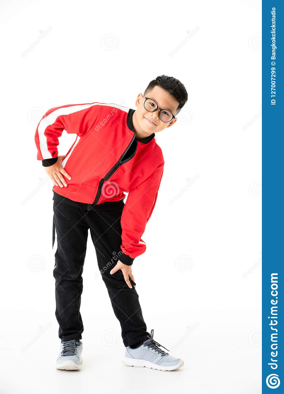 Young and handsome young Asian boy in red and black cloths stand