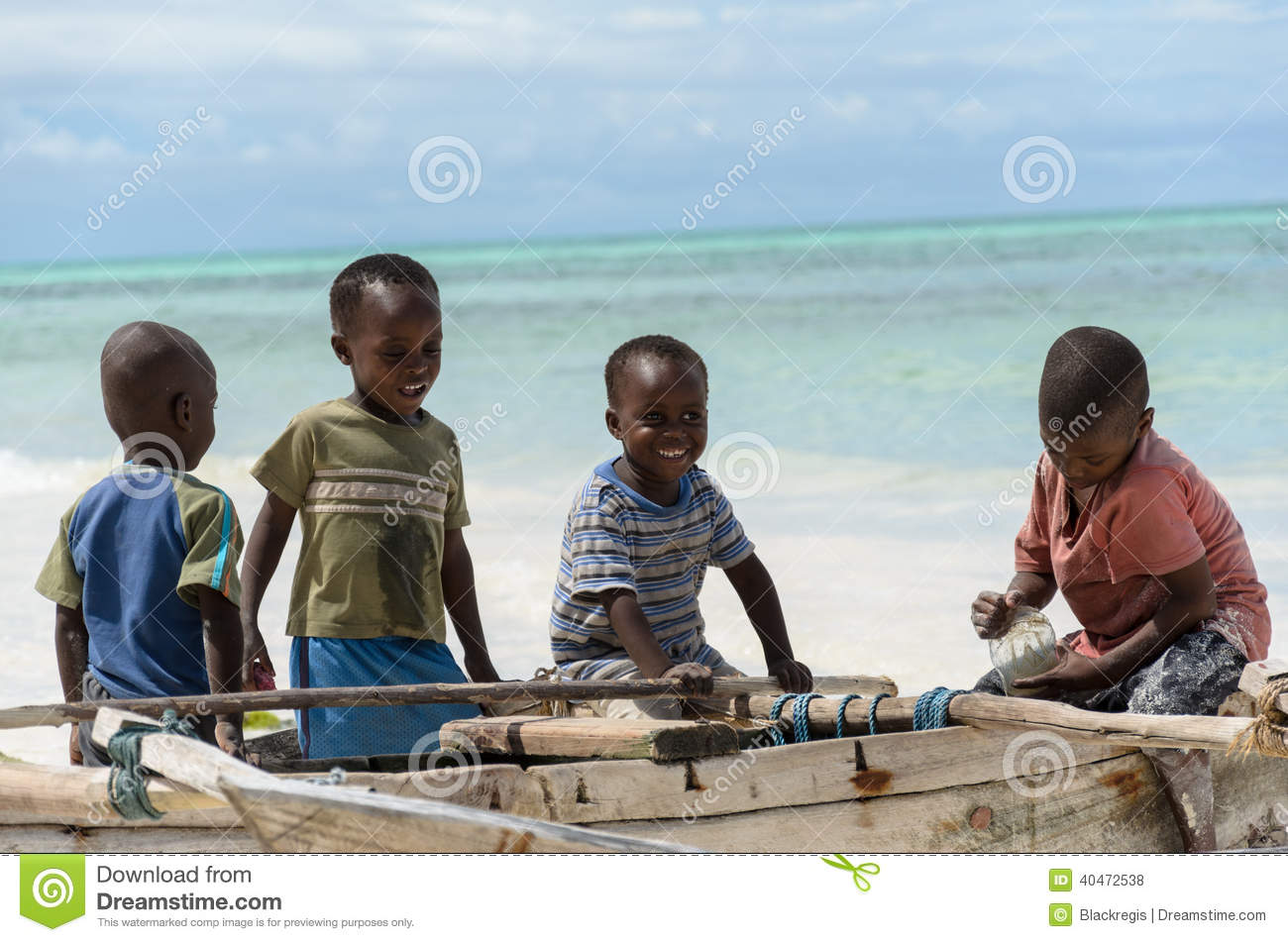 Young happy african boys on fishing boat