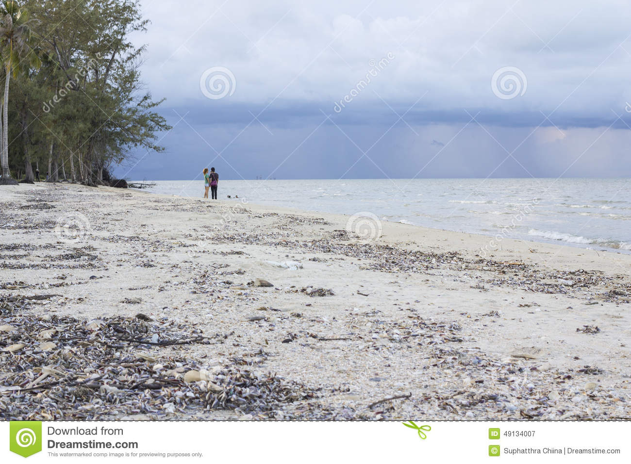 Young happy Asian Thai couple on tropical beach