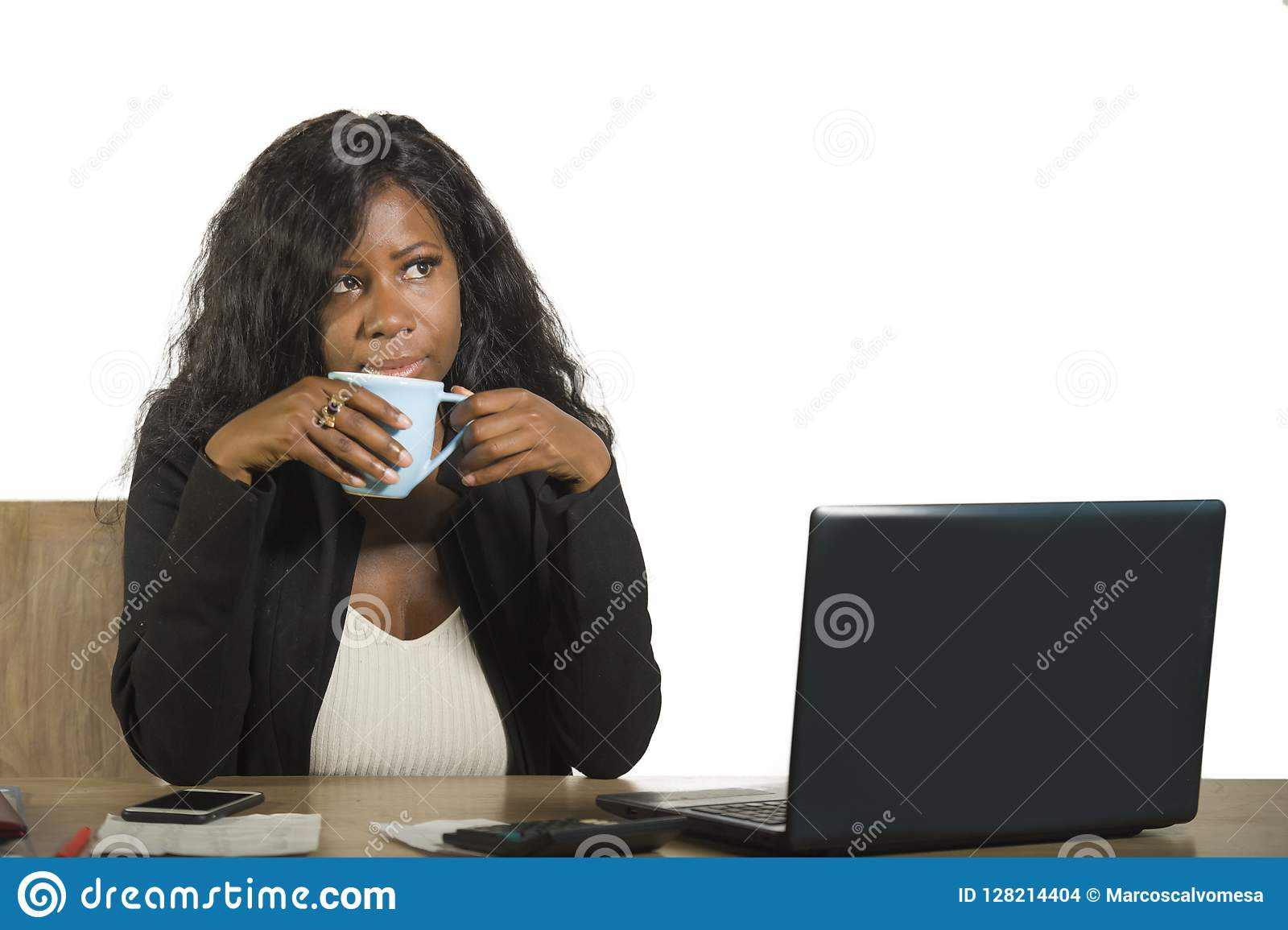 Young happy and attractive black afro American business woman working at office computer desk smiling drinking cup of coffee relax