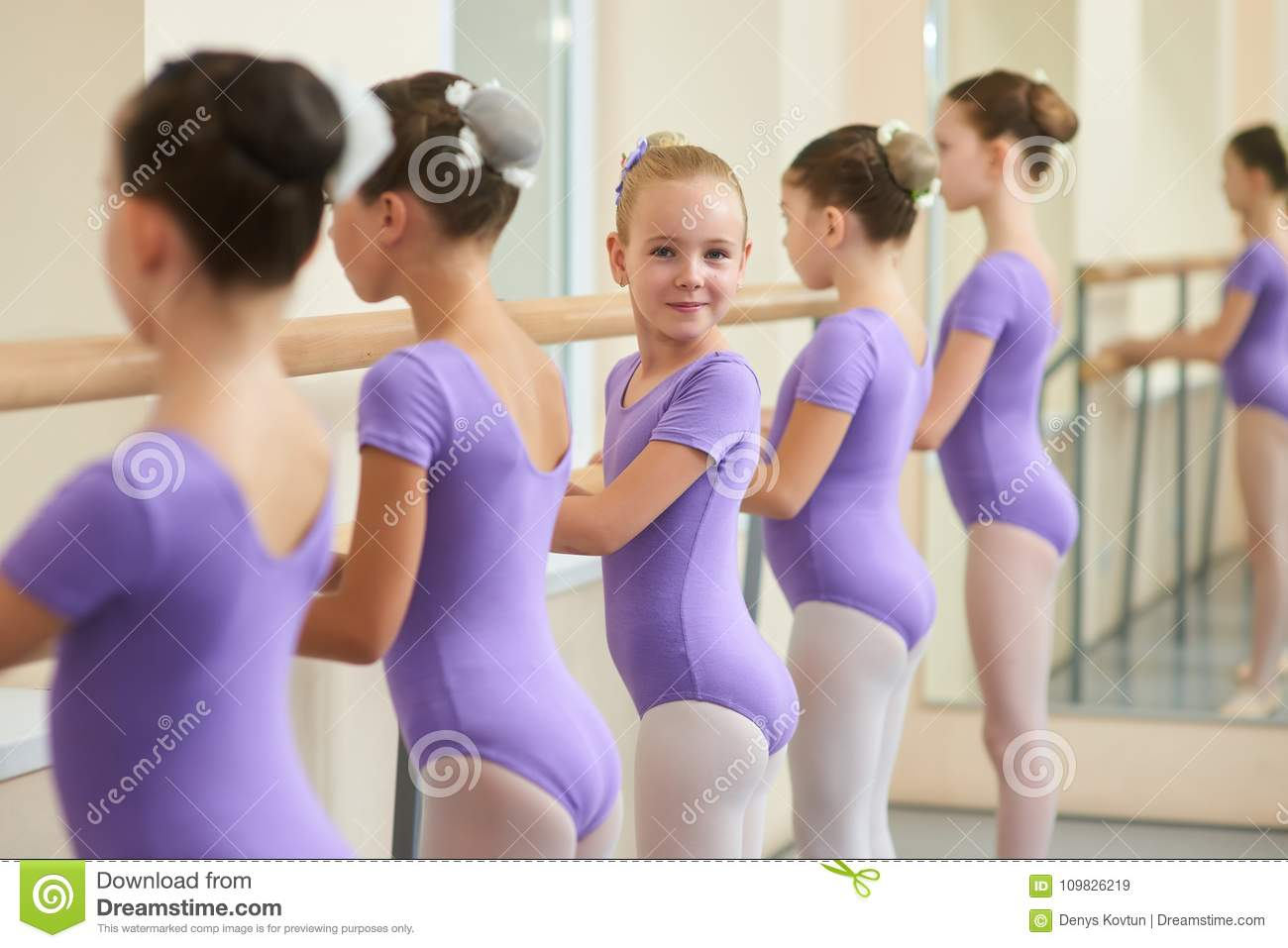3f879098edde Young Happy Ballerina Near Ballet Barre. Stock Image - Image of hall ...
