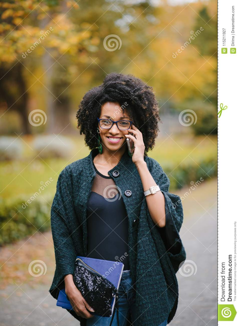 Happy Black Woman During A Mobile Phone Call In Autumn Stock Image