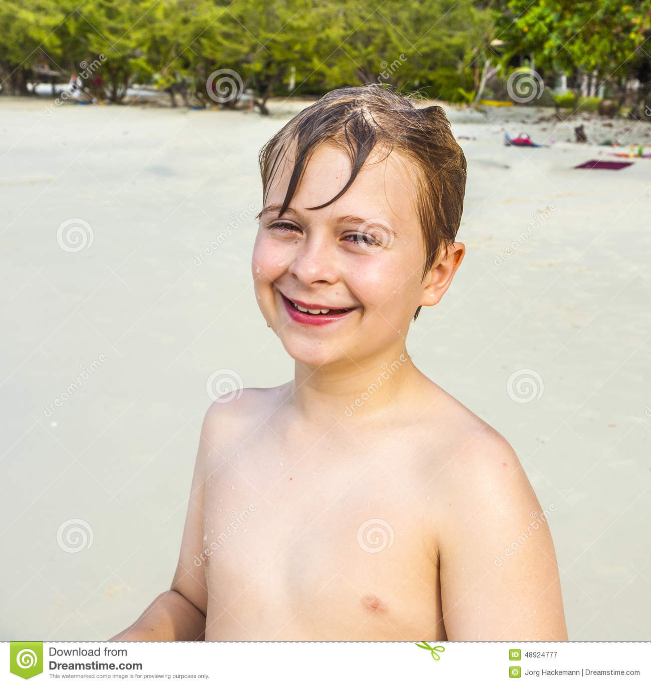 Happy Beautiful Woman Enjoying At Beach Stock Photo: Young Happy Boy With Brown Wet Hair Is Smiling And