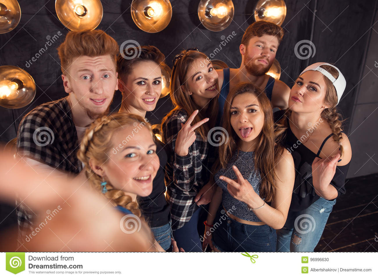 Young happy cheerful students making selfie in campus