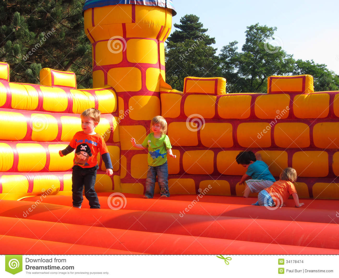 Young happy children playing, jumping,bouncy castl