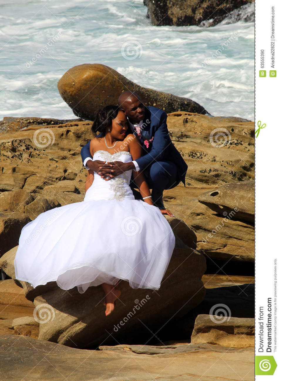 Young Happy Couple On The Beach Wedding Photo Editorial Image