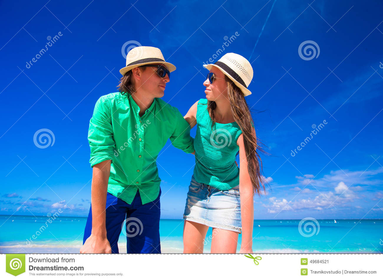 Young happy couple during tropical beach vacation stock for Tropical vacations for couples