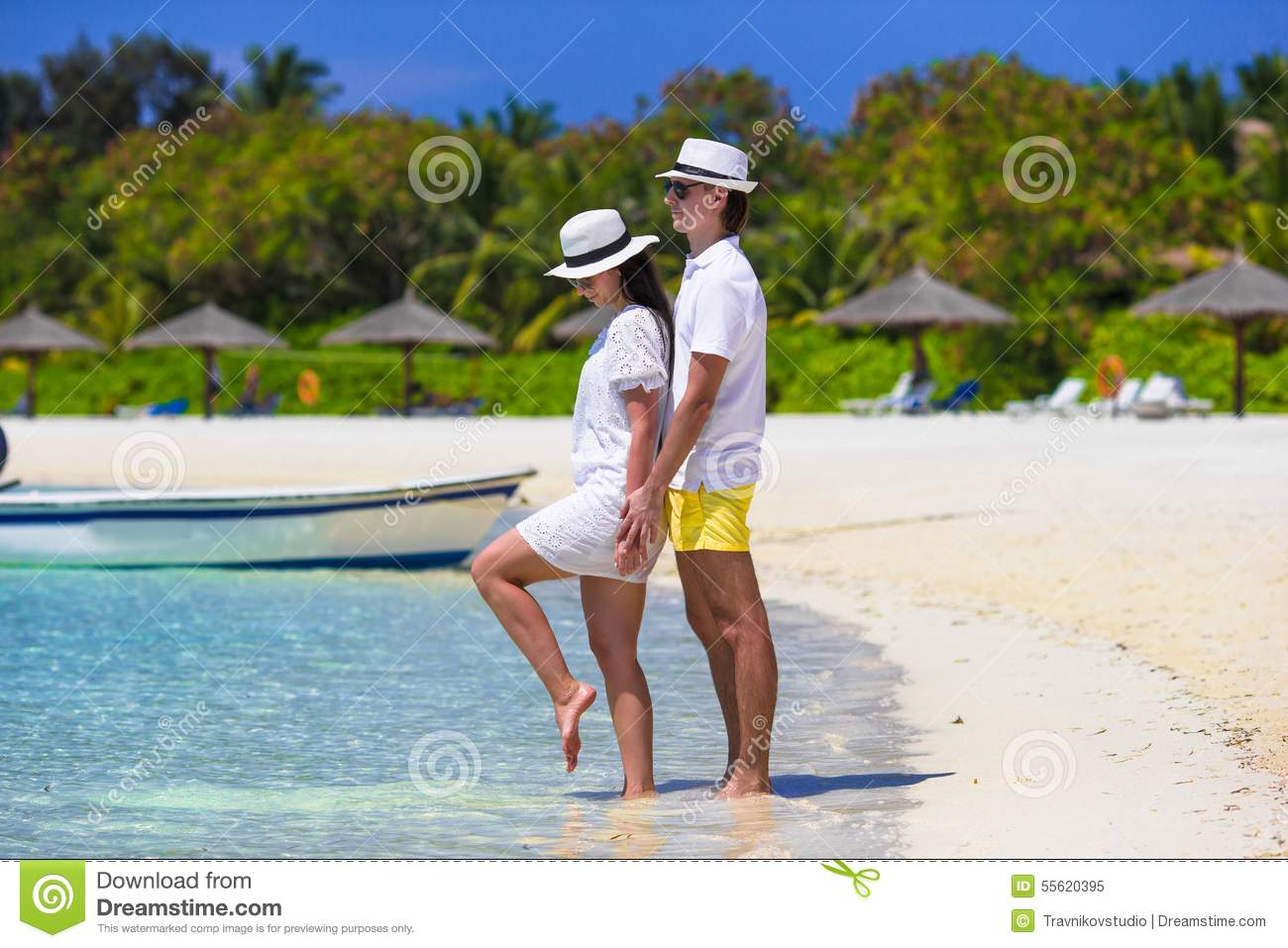 Young happy couple on white beach at summer