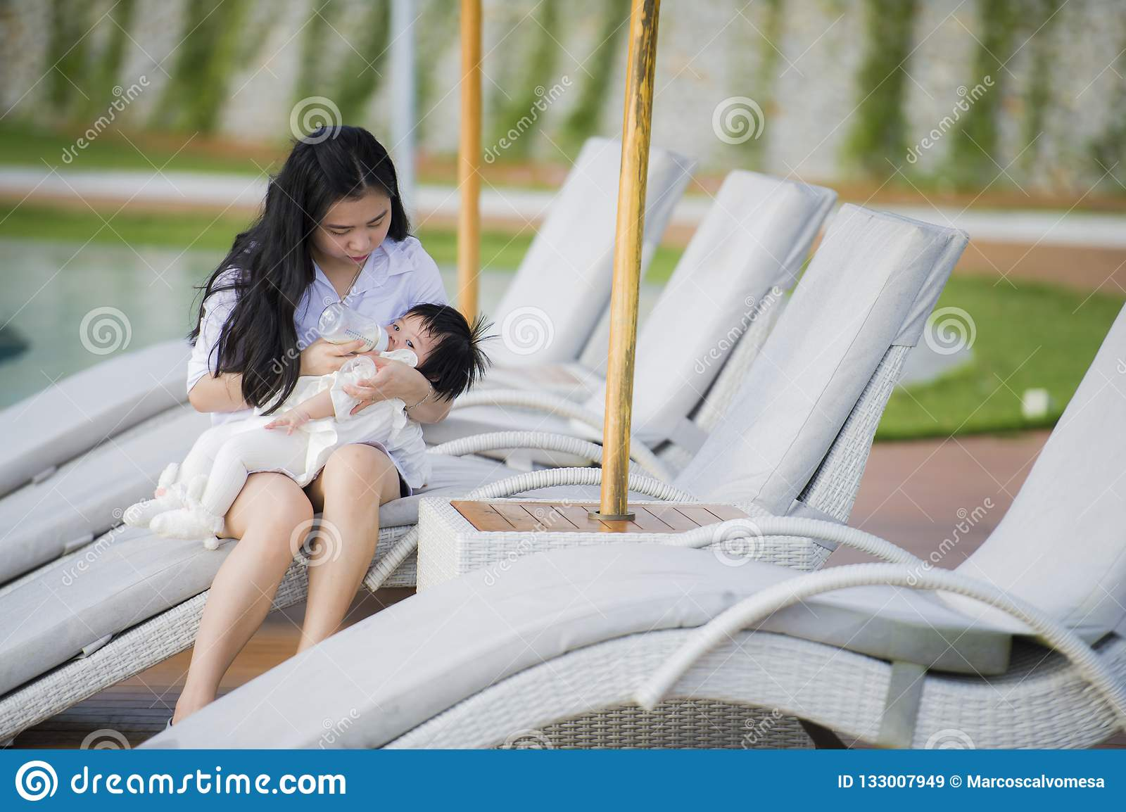 Young happy and cute asian chinese woman nursing daughter - Volume of a swimming pool formula ...