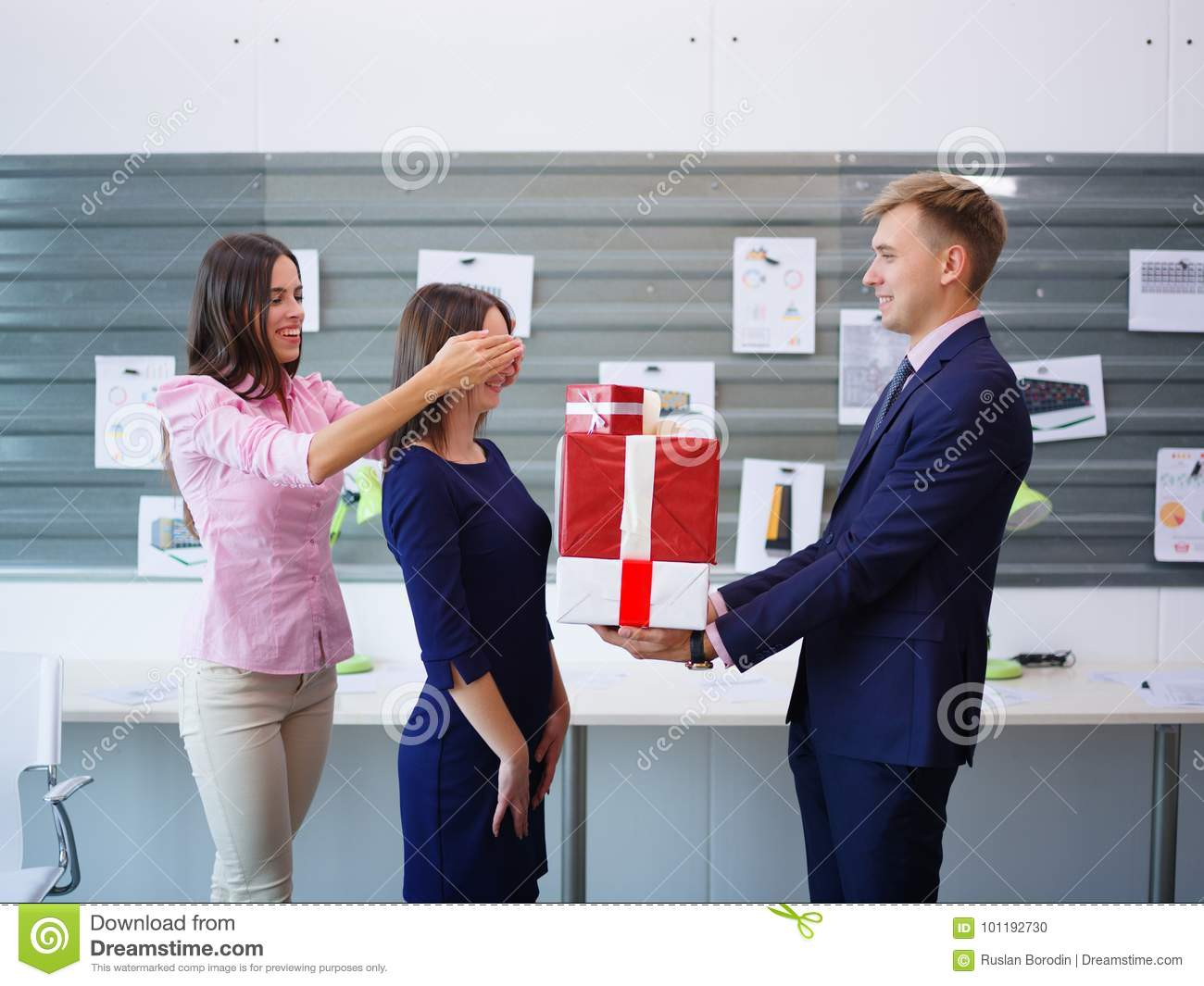 Beautiful Young Brunette And Handsome Man With A Big Gift For Colleague Business Concept