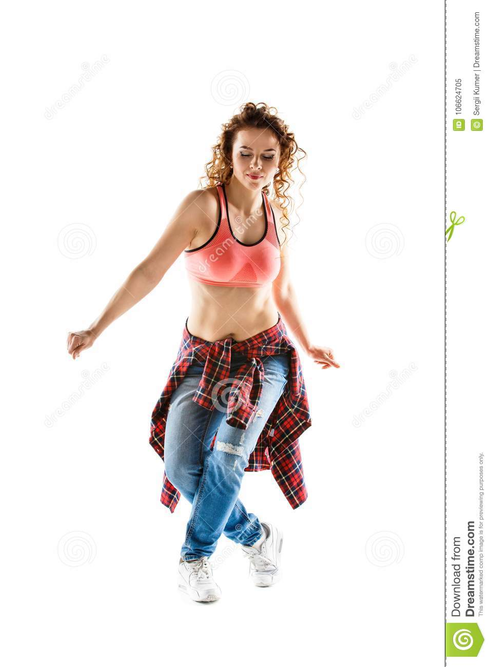 Young happy woman dancing against white background