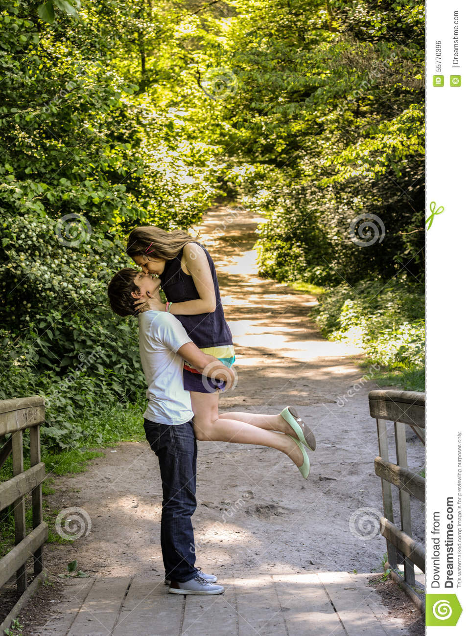 Young happy loving couple enjoy a moment of happiness in forest.