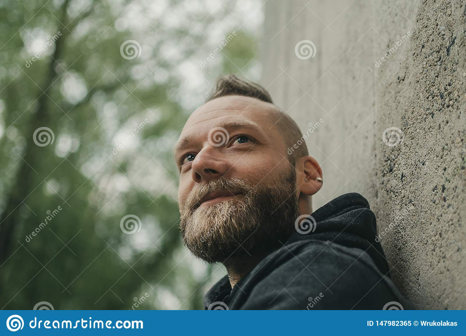 Man looks into distance and smiles