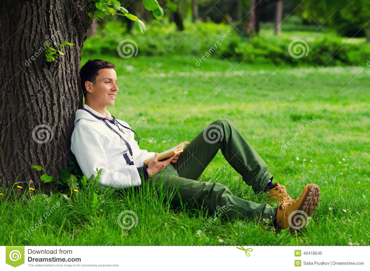 young-happy-man-reading-book-nature-beau