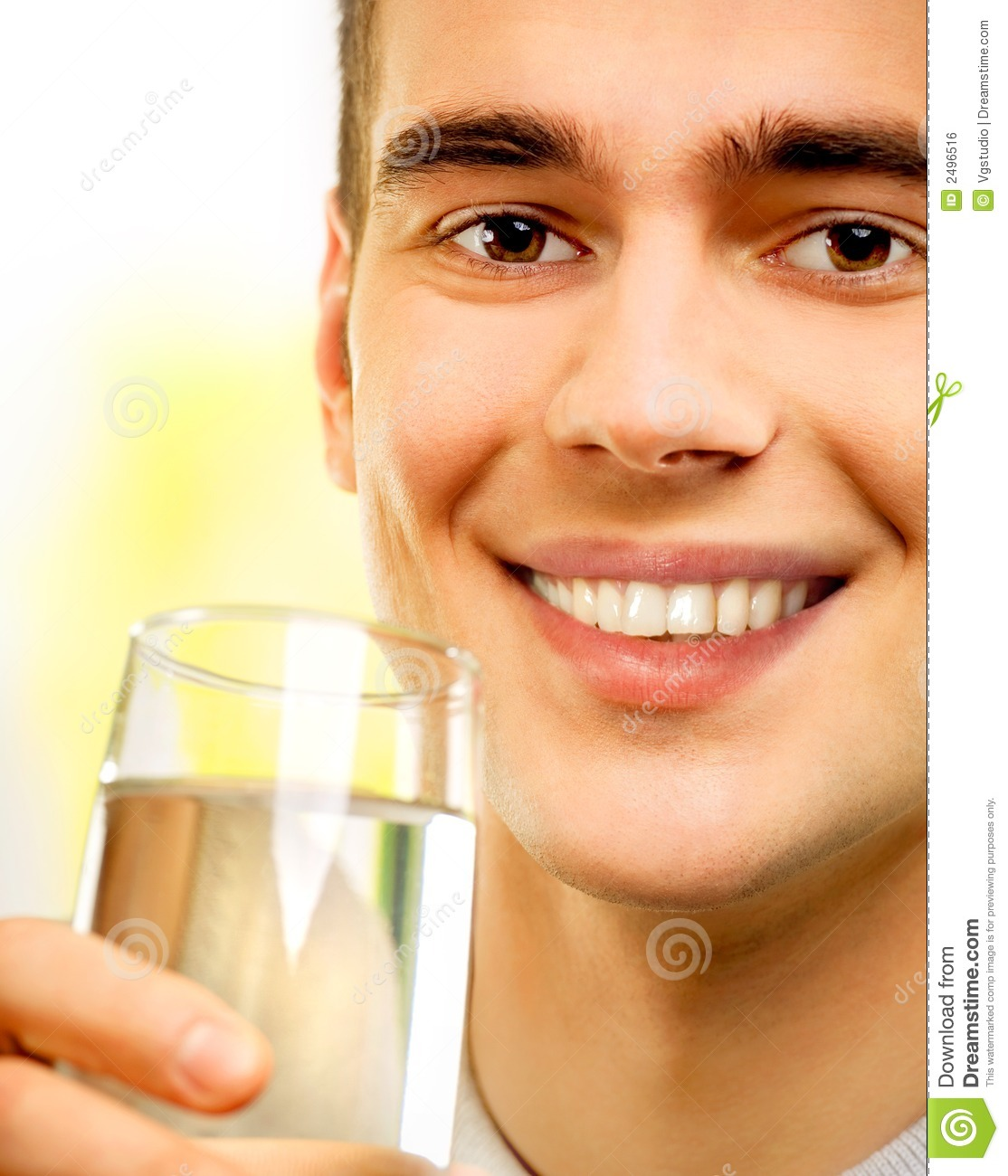 Young happy man with water