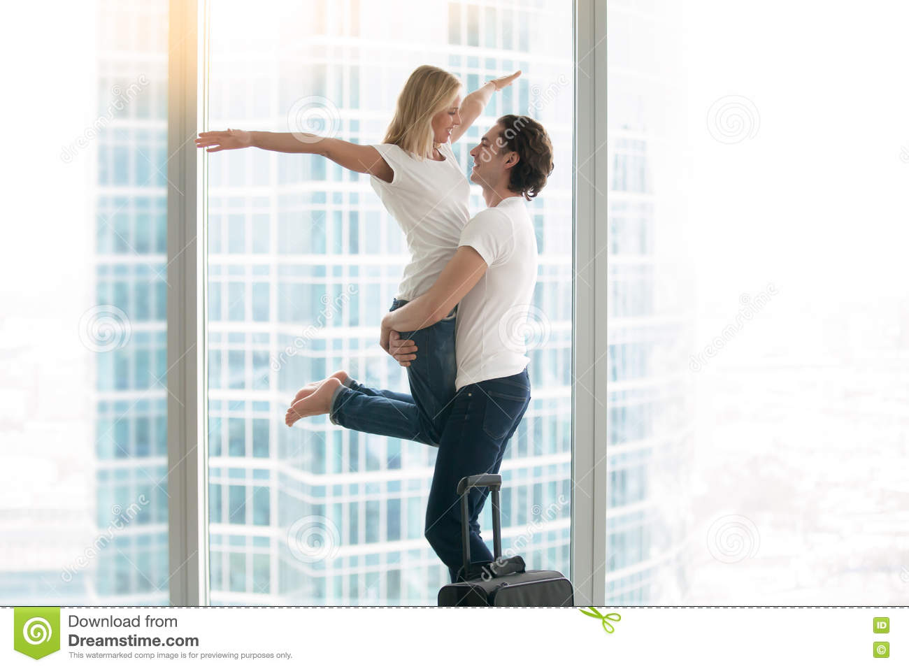 Young happy man and woman family in a modern flat