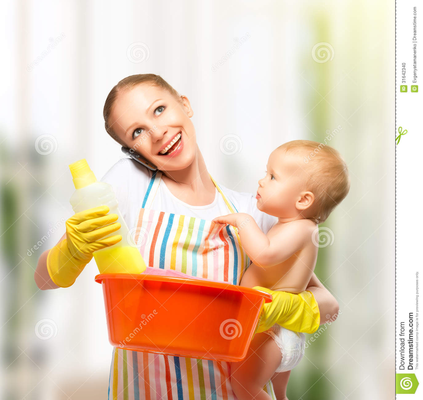 young happy mother is a housewife with a baby does