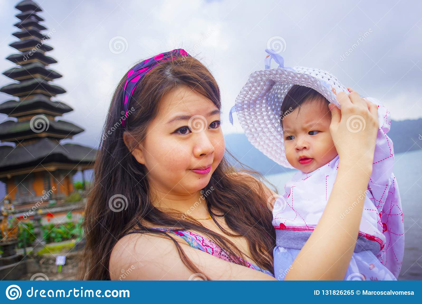 The Most Used Chinese Mail Order Brides young happy pretty asian chinese woman as loving mother holding adorable daughter baby girl holidays excursion visiting 131826265