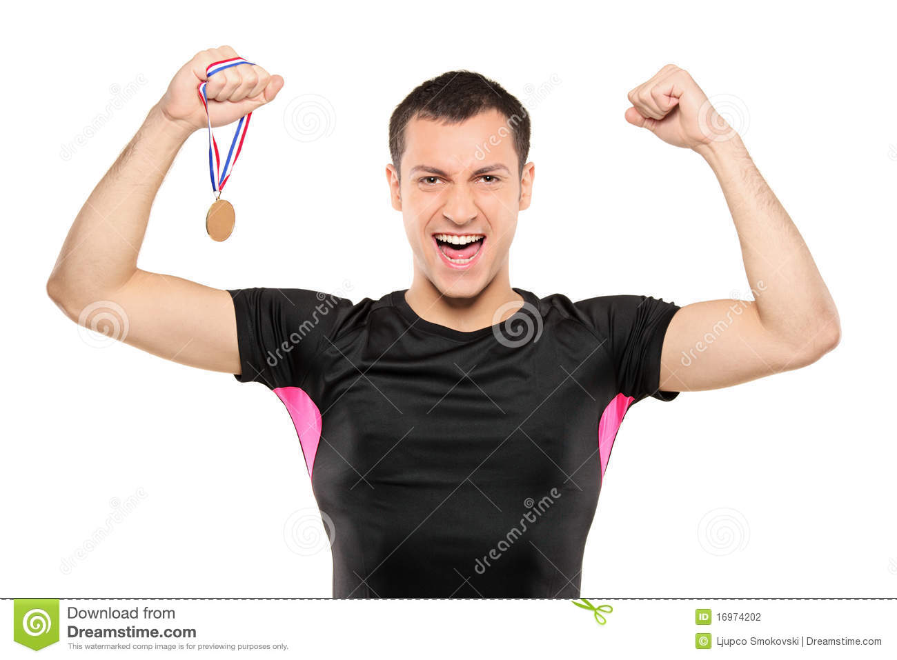 young happy sportsman holding a gold medal stock