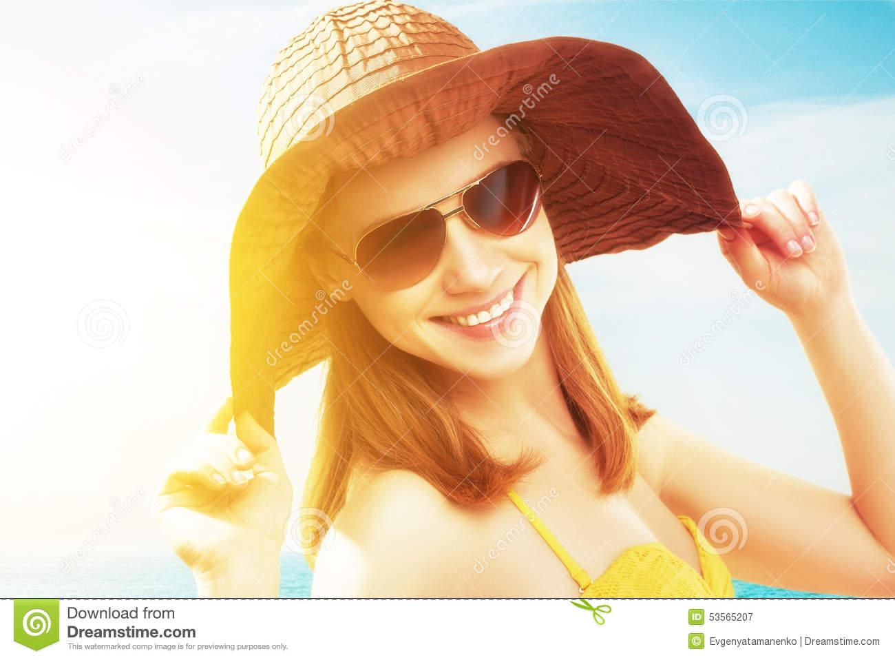 96ac27032b1 Young Happy Woman On The Beach In Sunglasses And A Hat Stock Image ...