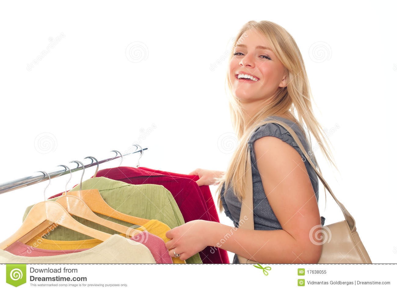 Royalty Free Stock Photo: Young happy woman in clothes store