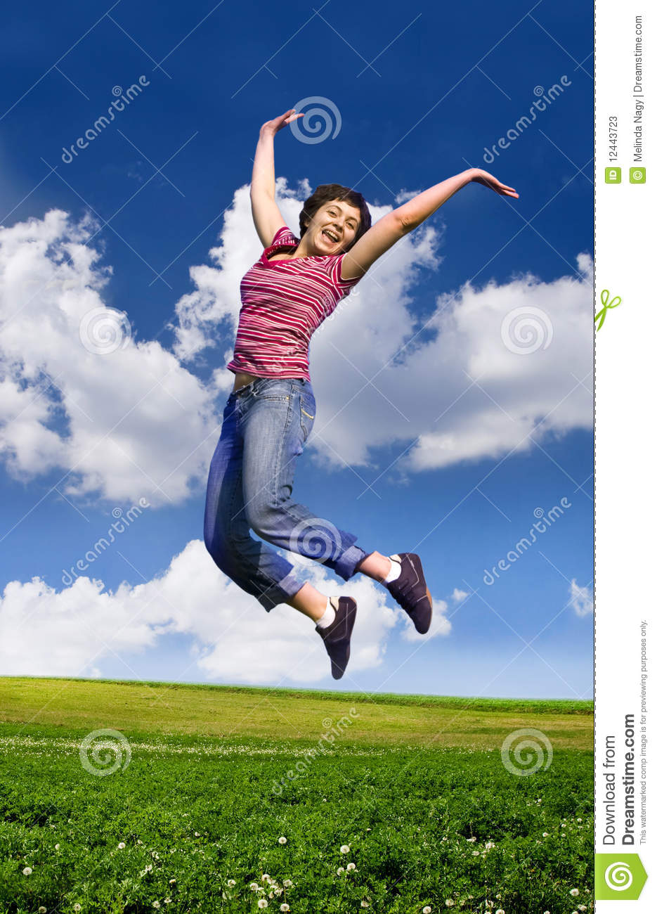 Young Happy Woman Jumping High Against Blue Sky Stock ...