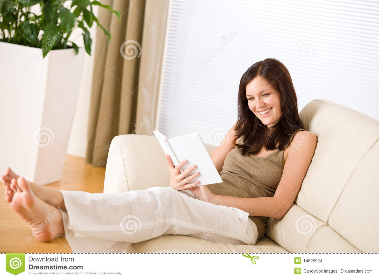 10cebdb46026 Young Happy Woman Read Book On Sofa Stock Photo - Image of woman ...