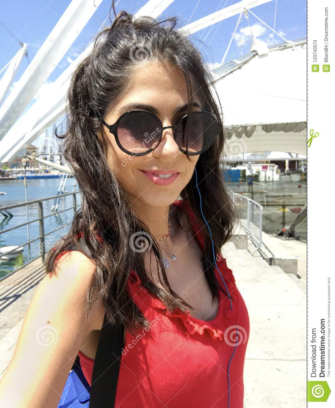 Young Happy Woman with Sunglasses Enjoying her Summer Vacation in Italy