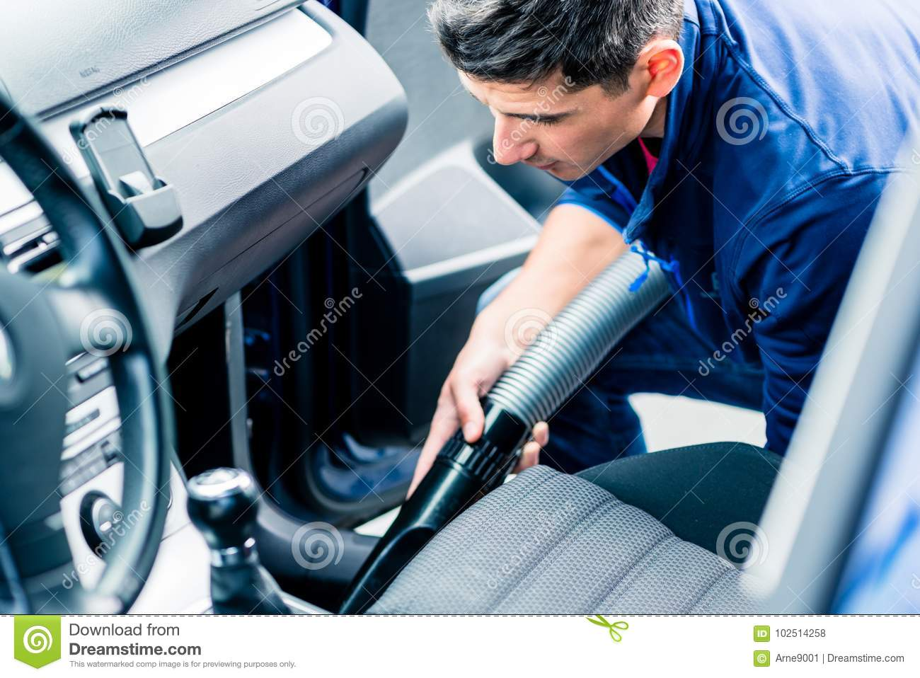 Download Young Man Using Vacuum For Cleaning The Interior Of A Car Stock  Photo   Image