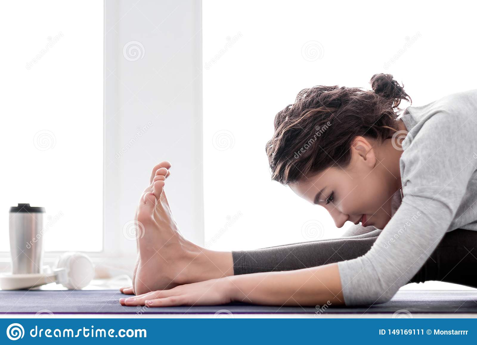 Young woman doing yoga workout at home