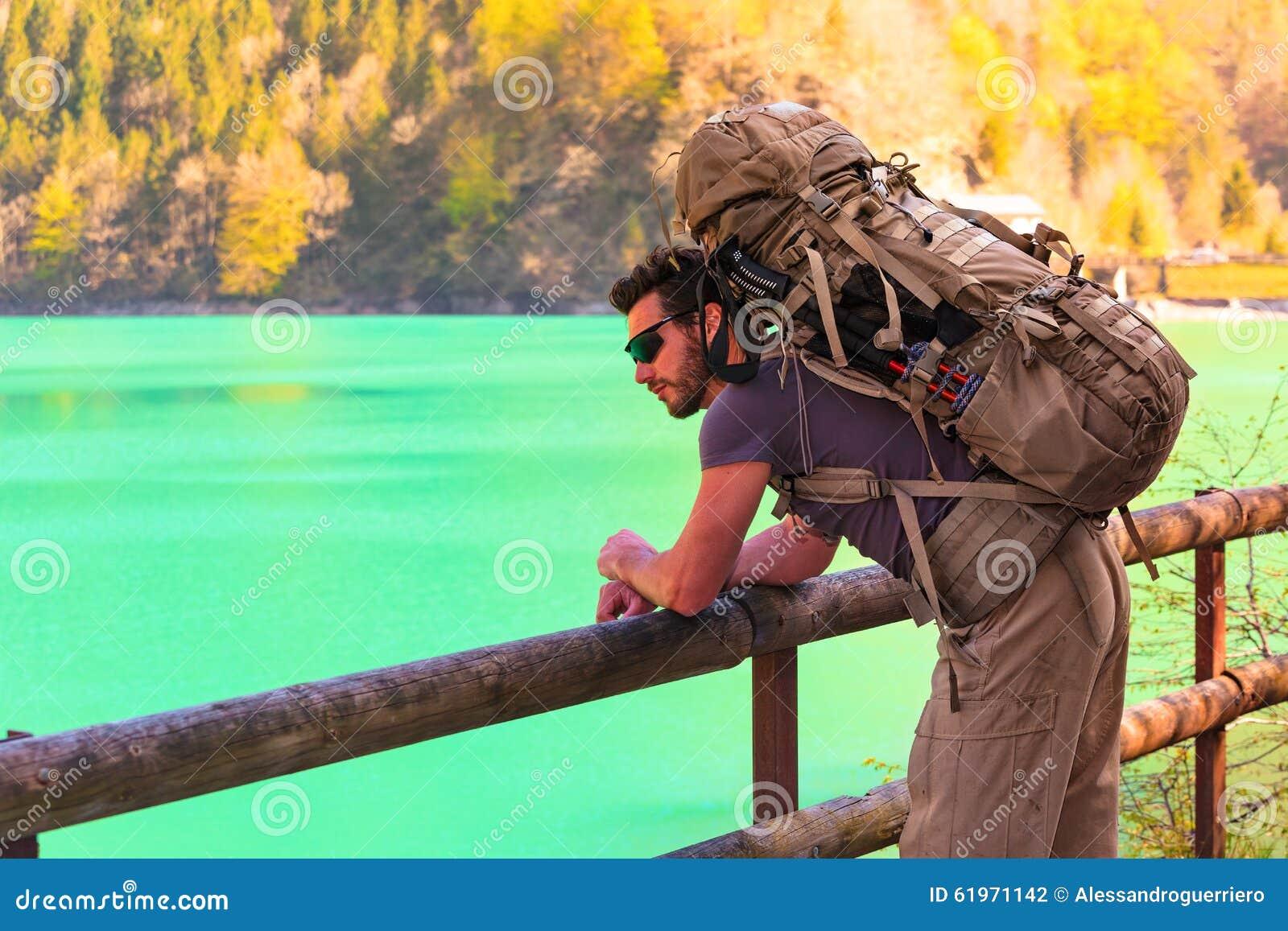 Young Hiker looking at a mountain lake