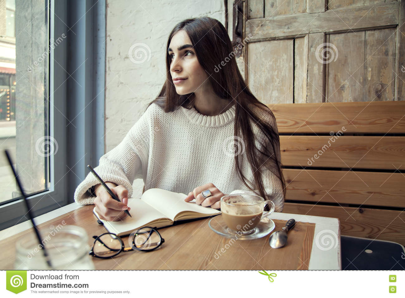 https://thumbs.dreamstime.com/z/young-hipster-girl-work-cafe-note-pad-cafe-near-window-lunch-time-coffee-70780561.jpg