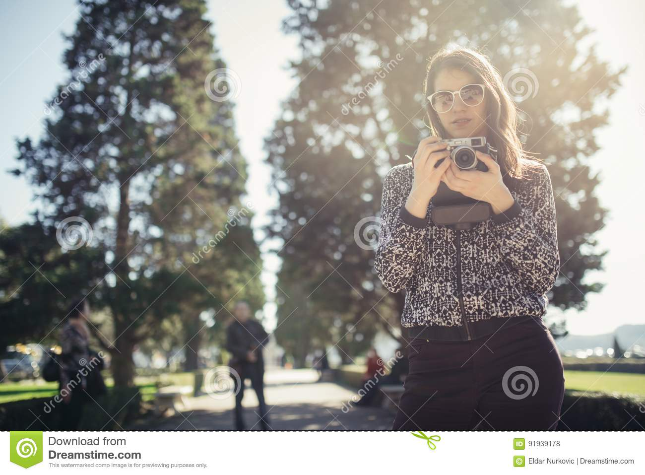 Young hipster tourist street photographer visiting colourful Lisbon.Enjoying colourful and busy city life