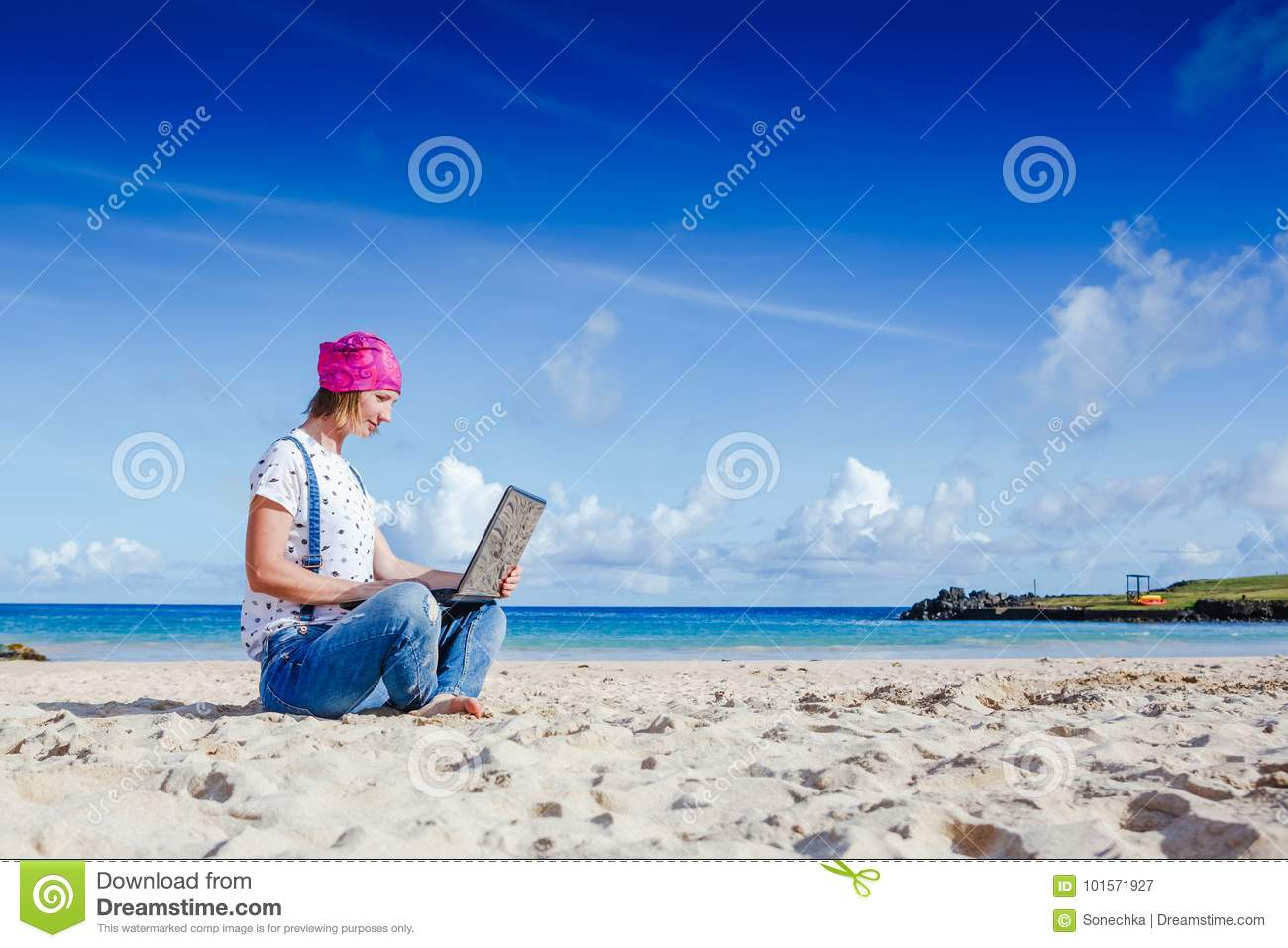 Young hipster woman working on laptop outdoor