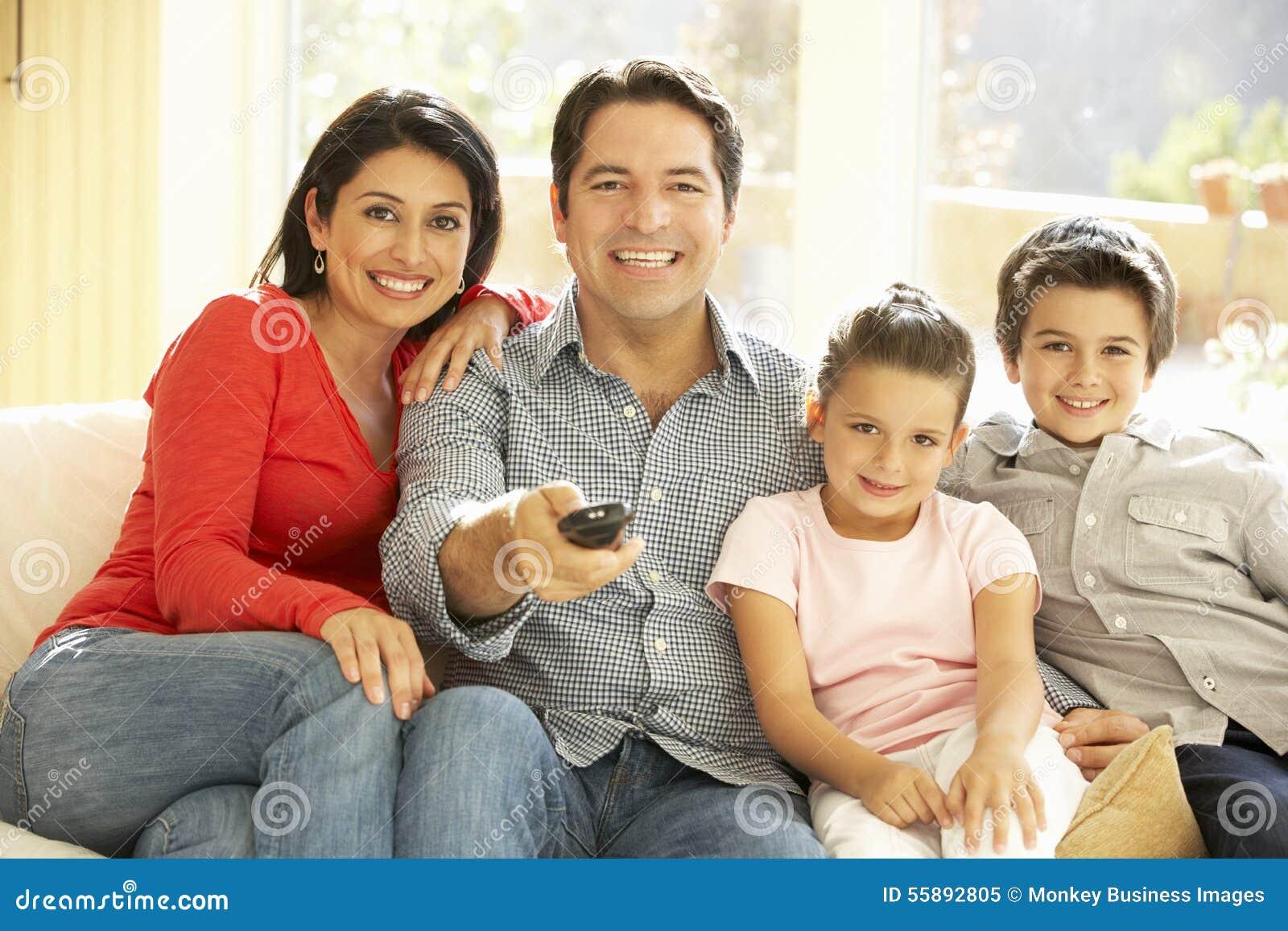 hispanic family watching tv -#main
