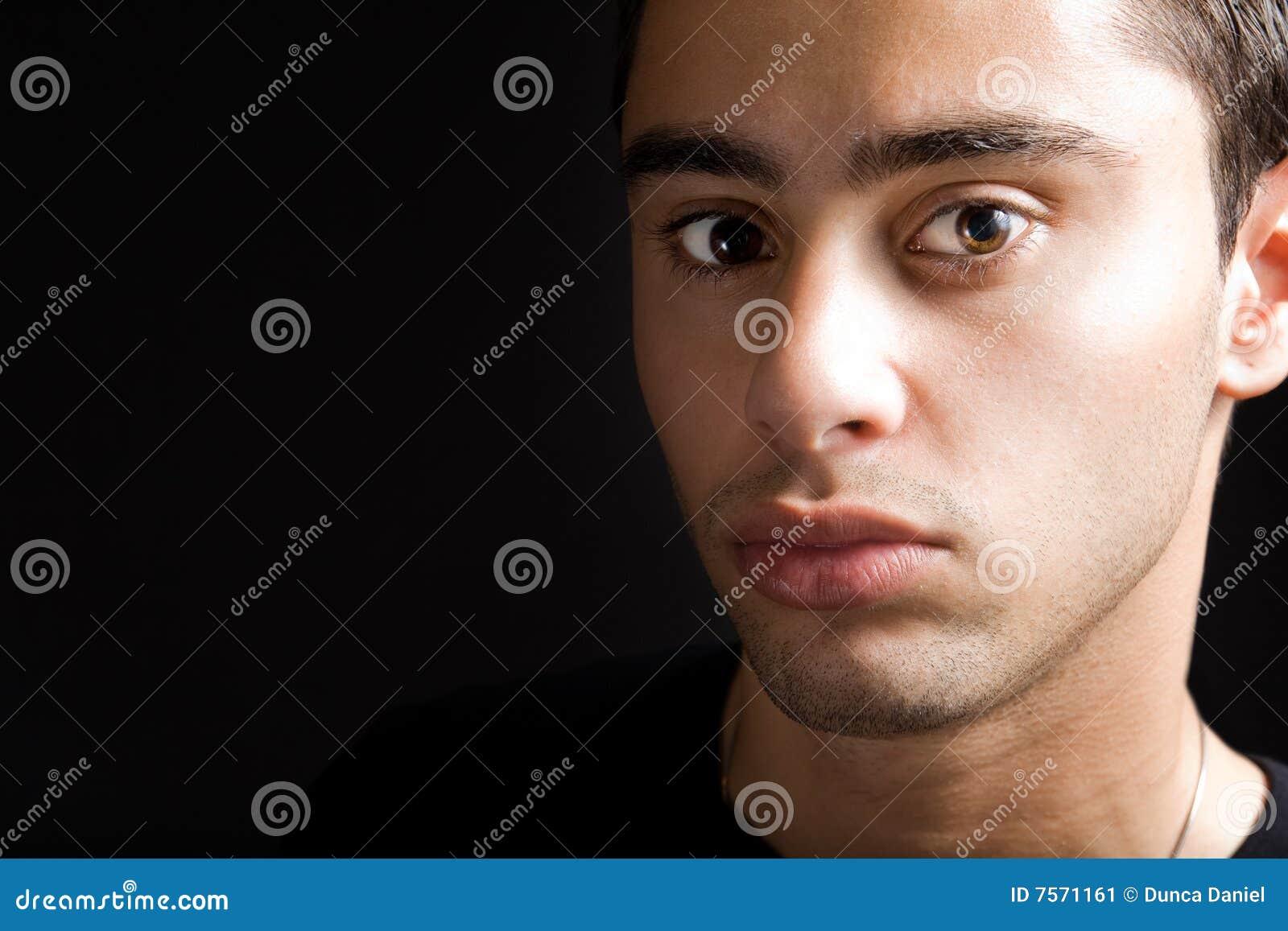 Young hispanic man with sensual face
