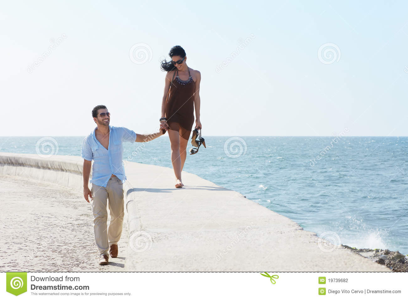 Young Husband And Wife Walking Near The Sea Stock Photo ...