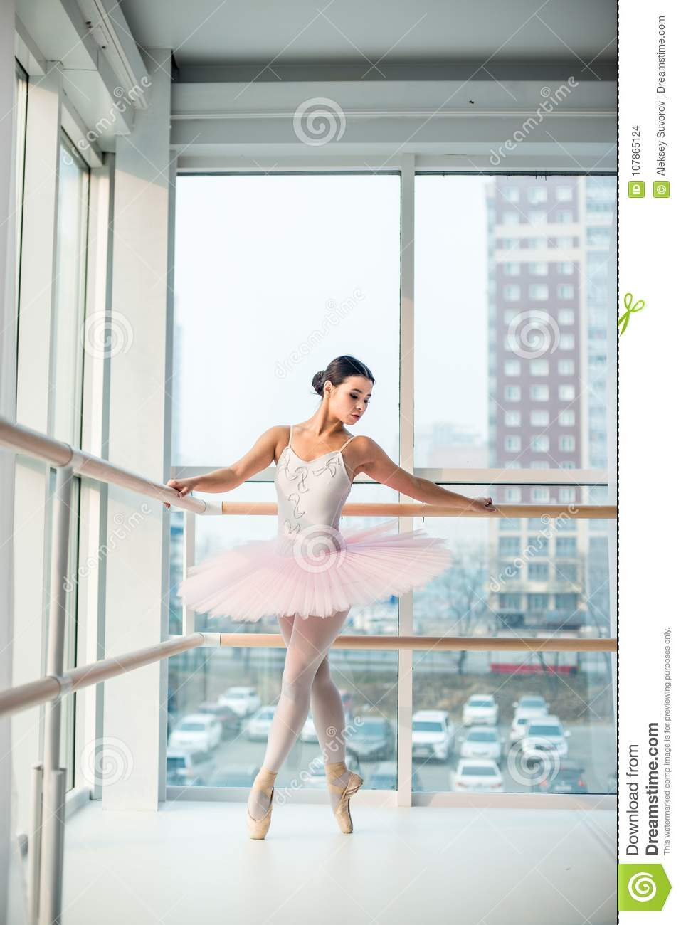 Young And Incredibly Beautiful Ballerina Is Posing And Dancing In A White Studio Full Of Light Stock Photo Image Of Body Jump 107865124
