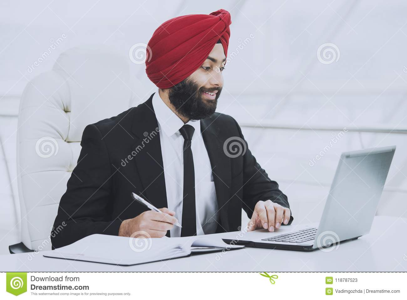 Young indian bearded businessman working