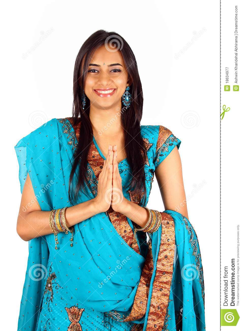 Young Indian in a namaste(greeting) pose. Isolated on a white ...