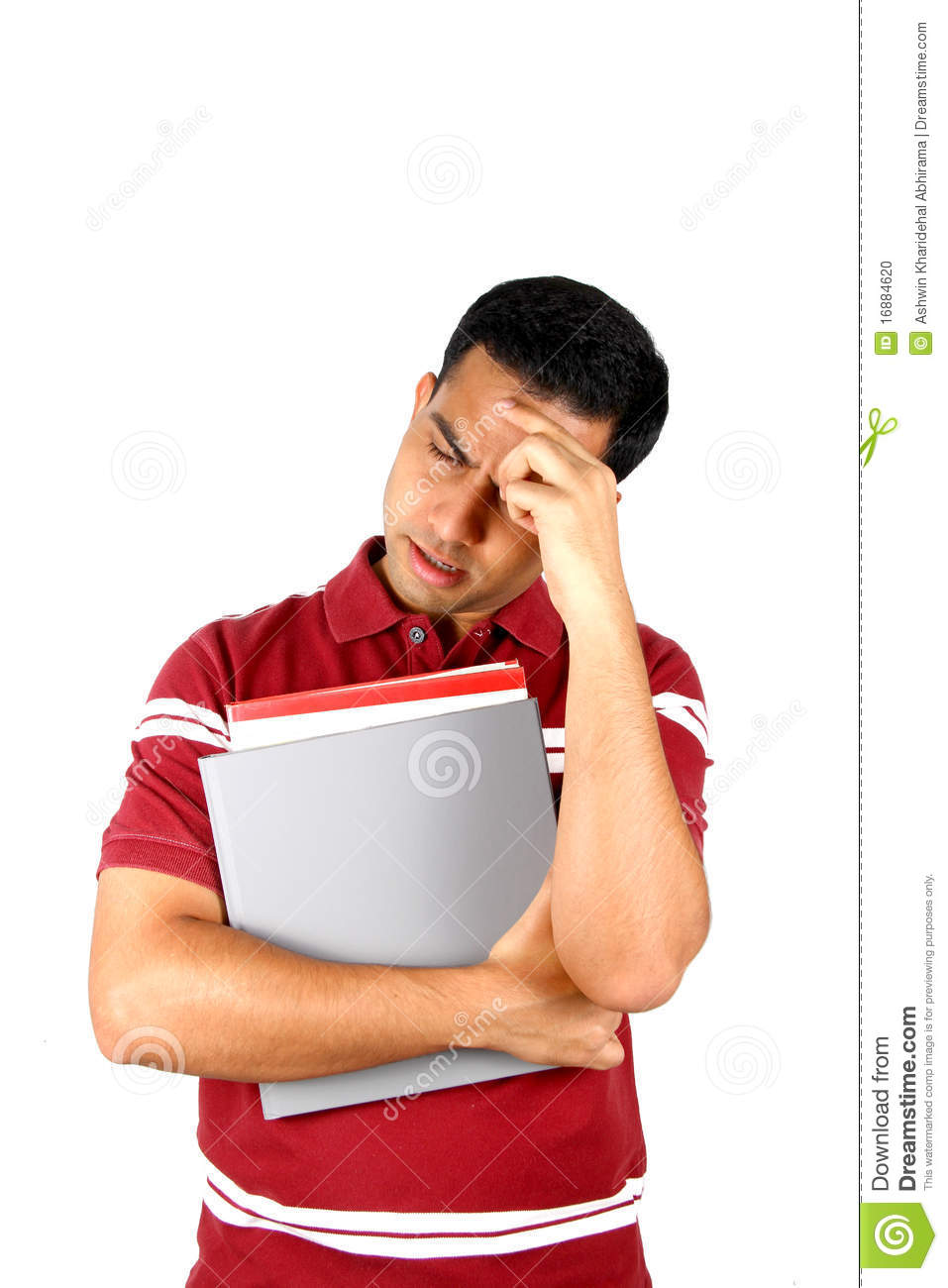 young indian student holding his head in stress stock
